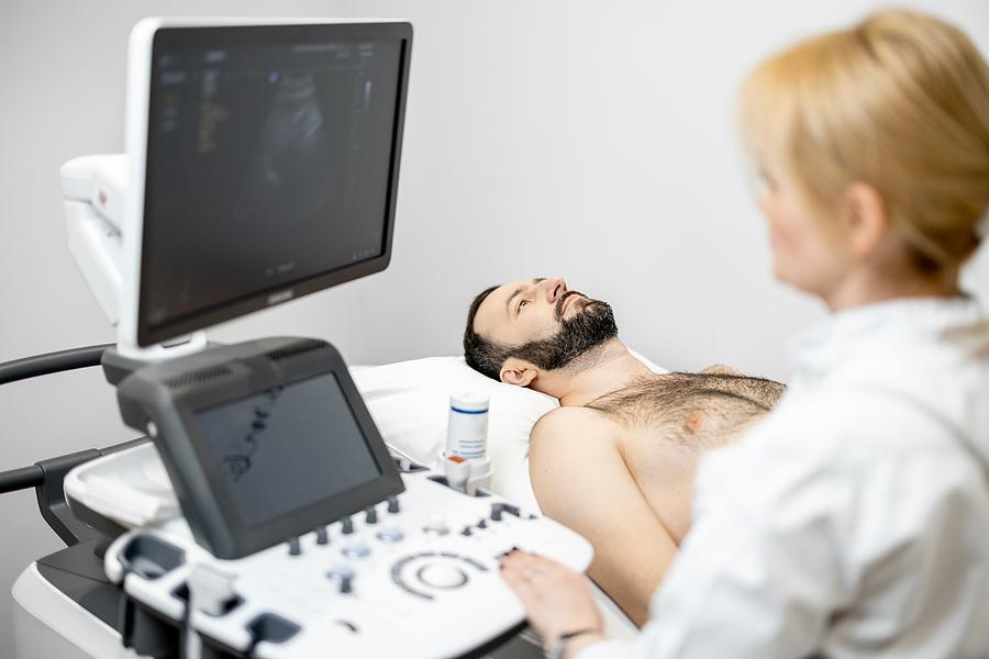 Man undertaking a liver scan procedure